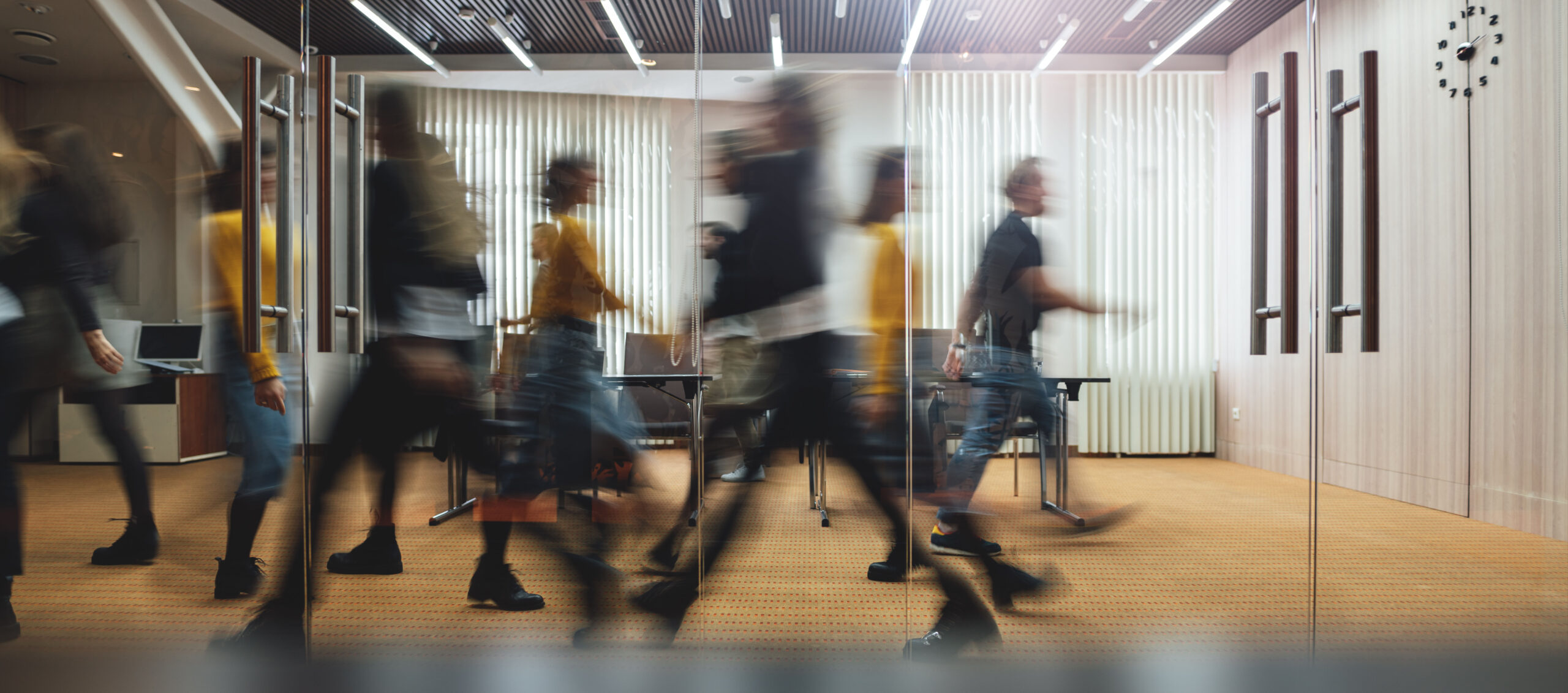 Businesspeople walking at modern office. Group of business employees at coworking center. Motion blur. Concept work process.